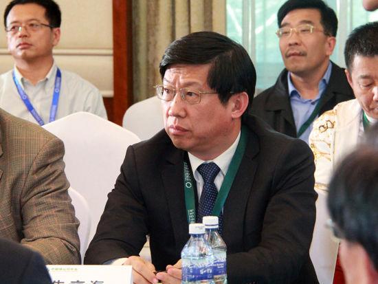 """""""2015中国绿公司年会""""于4月20日在沈阳举行。上图为辽宁省环保保护厅的厅长朱京海。(图片来源:新浪财经刘海伟 摄)"""